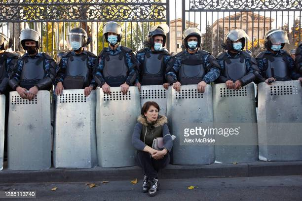 Riot police stand in formation as protesters march to demand the removal of Armenian Prime Minister Nikol Pashinyan from office outside the Armenian...