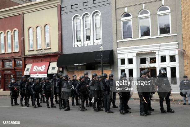 Riot police stand in formation during a 'White Lives Matter' rally on October 28 2017 in Murfreesboro Tennessee Tennessee Gov Bill Haslam said state...