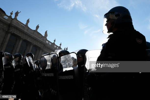 Riot police stand in line during a protest by students against the local government in downtown Turin on December 14, 2013. Protesters clashed with...