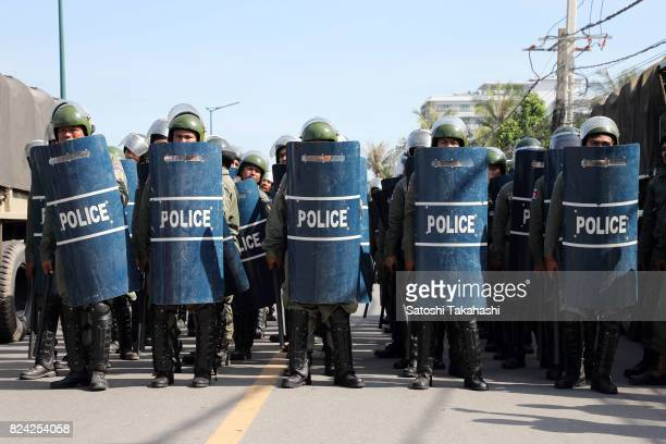 Riot police stand in line to prevent Khmer Krom activists march to the National Assembly to submit a petition seeking a new national holiday marking...