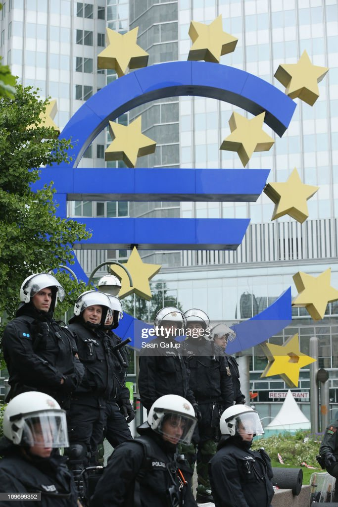 Riot police stand outside the headquarters of the European Central Bank (ECB) during Blockupy protests on May 31, 2013 in Frankfurt am Main, Germany. Several thousand protesters are taking part in Blockupy protests today and tomorrow in Frankfurt in order to demonstrate aginst ECB debt policy, food prices speculation by Deutsche Bank and the labor practices inherent in the discount clothing industry.