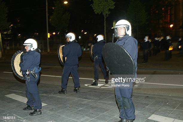 Riot police stand outside the parliament building to fend off demonstrators protesting against the assassination of controversial Dutch rightwing...