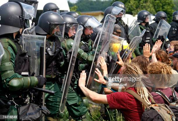 Riot police stop activists of the anti G8 forum 'Block G8' on a street on June 06 2007 in Nienhagen close to Heiligendamm Germany The activists are...
