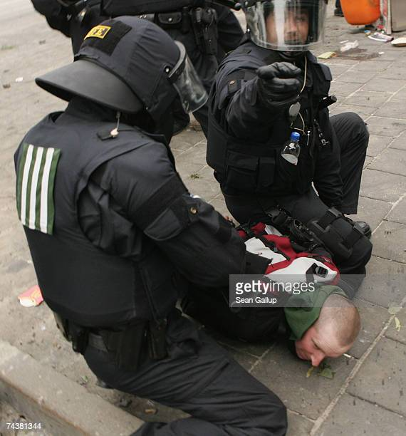 Riot police subdue a demonstrator during antiG8 protests that erupted into violence between mainly leftwing demonstrators and police June 2 2007 in...