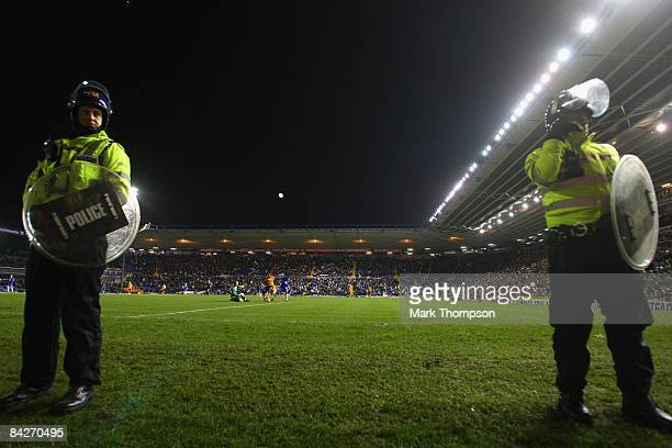 Riot police take to the pitch at St Andrews during the FA Cup sponsored by EON Third round match between Birmingham City and Wolverhampton Wanderers...
