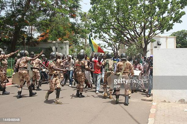 Riot police try to block some of thousands of Malians trying to enter the presidential compound on May 21 2012 in Bamako during a protest against a...