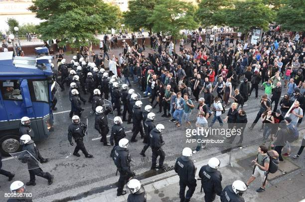 Riot Police use a water cannon during the 'Welcome to Hell' rally against the G20 summit in Hamburg northern Germany on July 6 2017 Leaders of the...