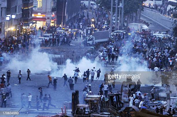 Riot police use tear gas to disperse protesters at the Gezi park near Taksim square in Istanbul on June 15 2013 Police fired tear gas and jets of...