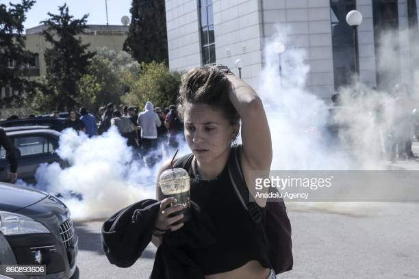 Riot police use tear gas to disperse the university students protesting against some regulations at universities outside the Greek Ministry of...