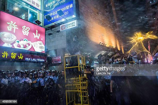 Riot police use tear spray during clash with protesters at Mong Kok on November 25 2014 in Hong Kong The Mong Kok protest site is scheduled for...