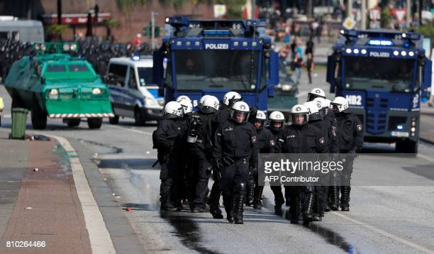 Riot police use water cannon against protesters on July 7 2017 in Hamburg northern Germany where leaders of the world's top economies gather for a...