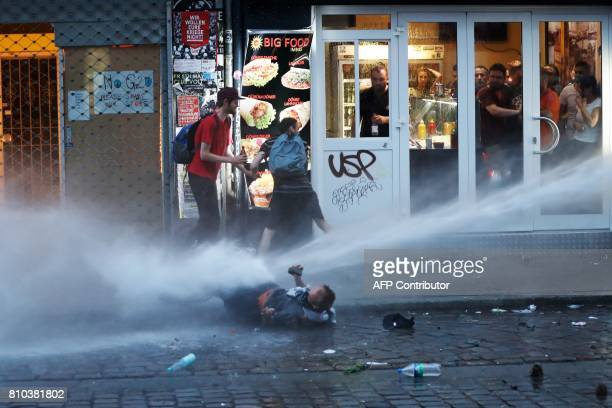 TOPSHOT Riot police use water cannon against protesters on July 7 2017 in Hamburg northern Germany where leaders of the world's top economies gather...