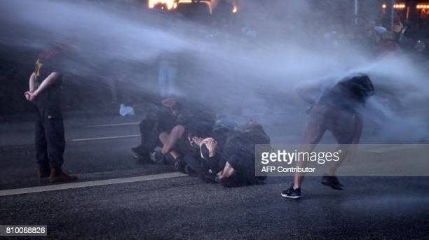 Riot police use water cannon during the 'Welcome to Hell' rally against the G20 summit in Hamburg northern Germany on July 6 2017 German police and...