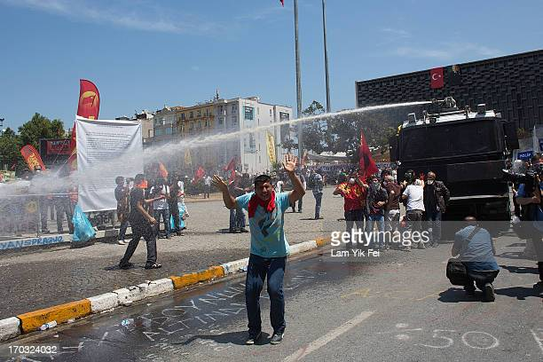 Riot police use water cannons and tear gas to disperse the crowd during a demonstration near Taksim Square on June 11, 2013 in Istanbul, Turkey....