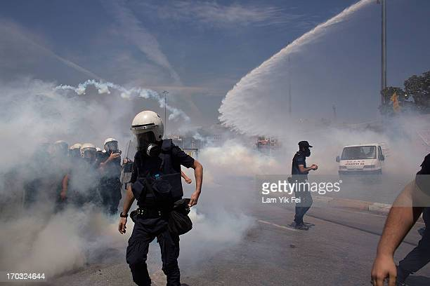 Riot police use water cannons and tear gas to disperse the crowd during a demonstration near Taksim Square on June 11 2013 in Istanbul Turkey...
