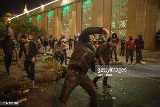 Riot police used tear gas and water cannon to disperse antigovernment protesters as they clashed for the second day in a row near the Parliament...