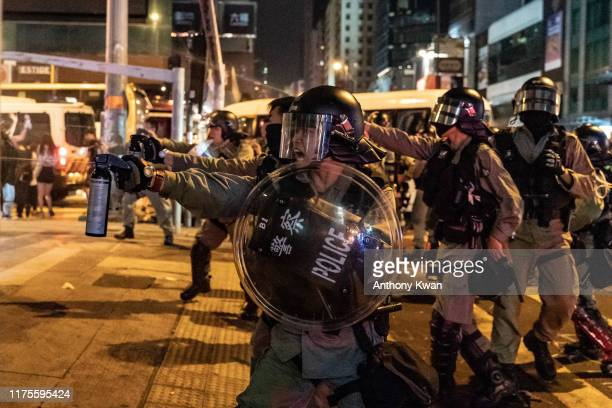 Riot police uses pepper spray in Mongkok district on October 13 2019 in Hong Kong China Hong Kong's government invoked emergency powers last week to...