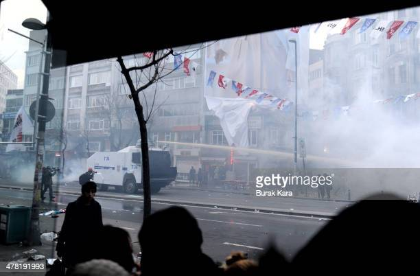 Riot police uses water cannons against protesters during clashes at the funeral of Berkin Elvan on March 12 2014 in Istanbul Riot police fired tear...