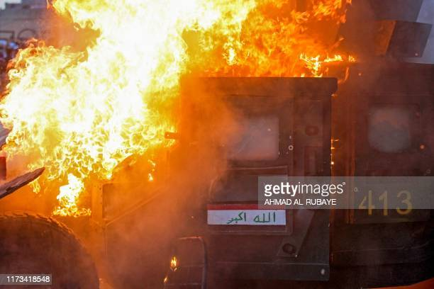 TOPSHOT A riot police vehicle burns during clashes amidst demonstrations against state corruption failing public services and unemployment in the...