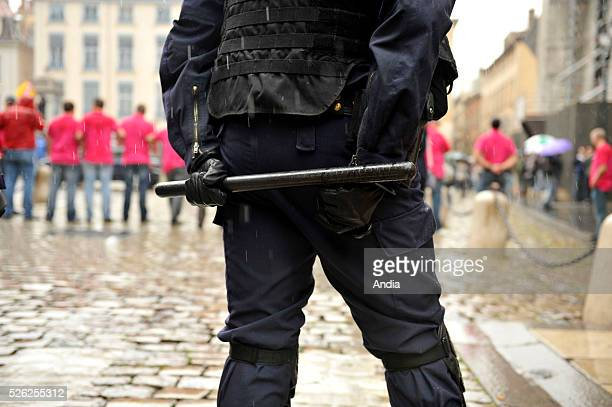 """Riot police viewed from behind during the protest of the """"Bloc identitaire"""", a French nationalist political group, in the streets of Lyon on May 14,..."""