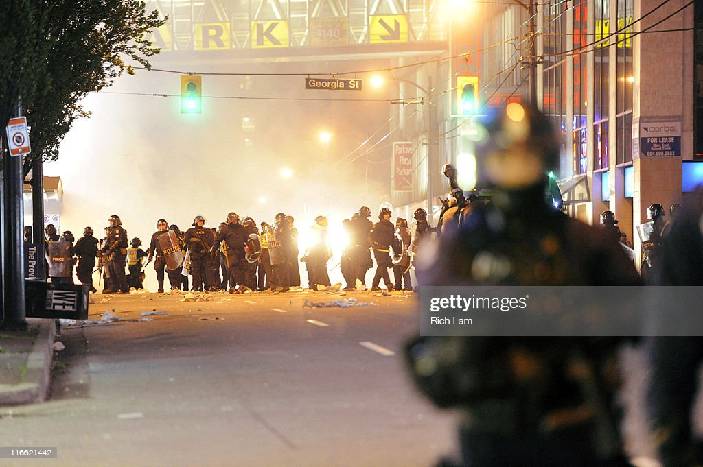 Riot police walk in the street on June 15, 2011 in Vancouver, Canada. Vancouver broke out in riots after their hockey team the Vancouver Canucks lost in Game Seven of the Stanley Cup Finals.