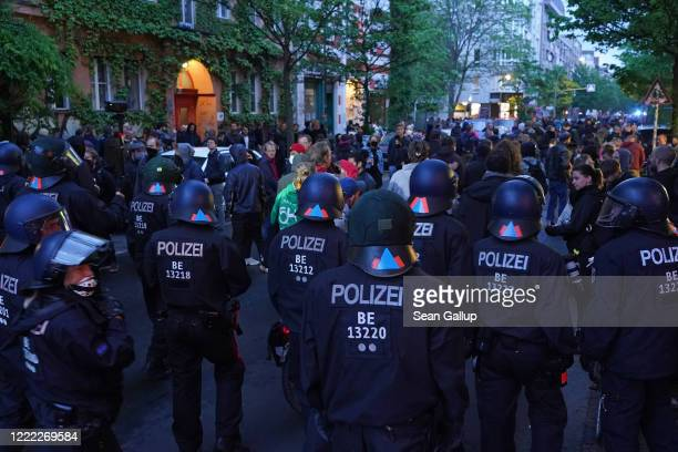 Riot police walk through a crowded street during scattered leftwing protests in Kreuzberg district on May Day during the novel coronavirus crisis on...