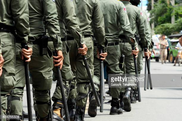Riot police walk to prevent Khmer Krom activists march to the National Assembly to submit a petition seeking a new national holiday marking the day...