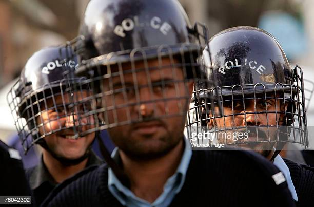 Riot Police watch over journalists protesting against emergency rule outside the Islamabad Press Club on November 21 2007 in Islamabad Pakistan...