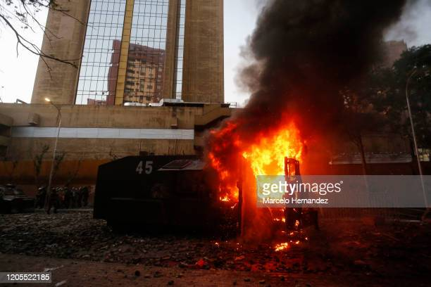 Riot police water cannon burns after demonstrators shot a molotov bomb during a protest against the government of President Sebastian Piñera on March...