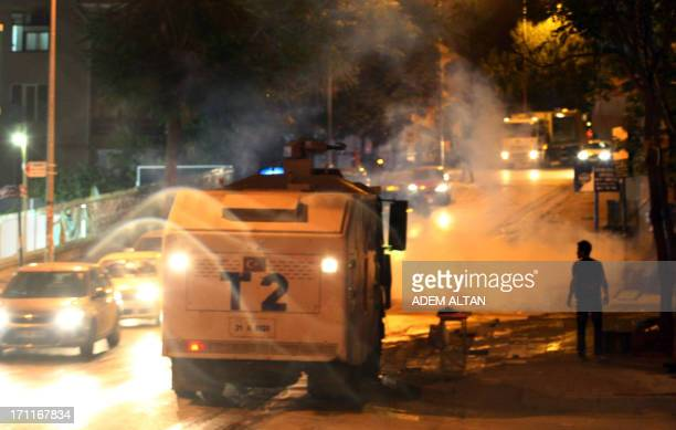 A riot police water cannon vehicule stationed in the street while antigovernment protesters stage a demonstration in Ankara June 22 2013 AFP PHOTO /...