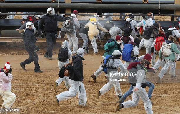 Riot police with pepper spray attempt to stop climate activists from the group 'Ende Gelaende' charging into the Hambach openpit coal mine on...