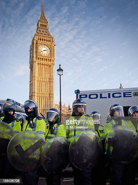 Riot Police with shields stand in front of Big Ben at a student demonstration that turned violent on December 9, 2010. The students were protesting...