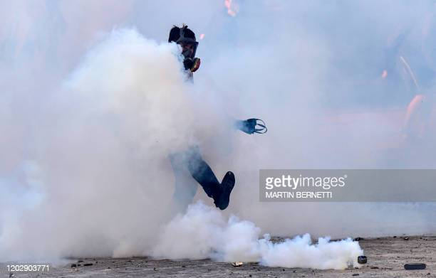 Riot policeman clashes with demonstrators during a protest against Chilean President Sebastian Pinera's government in Vina del Mar, on February 23...