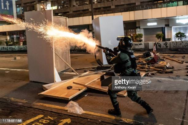 Riot policeman fires teargas on a street in Mongkok district on October 27, 2019 in Hong Kong, China. Anti-government demonstrations in Hong Kong...