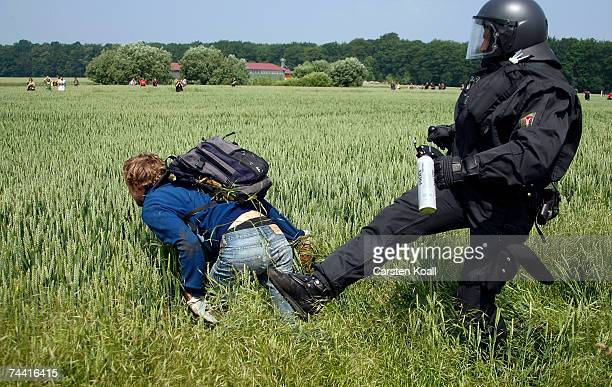 A riot policeman kicks an activist of the anti G8 forum Block G8 as they protest in a field on June 06 2007 near Rethwisch close to Heiligendamm The...
