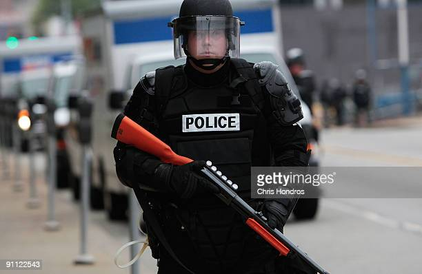 A riot policeman protecting the G20 Summit stands guard September 24 2009 in Pittsburgh Pennsylvania Marchers gathered in neighborhoods several miles...