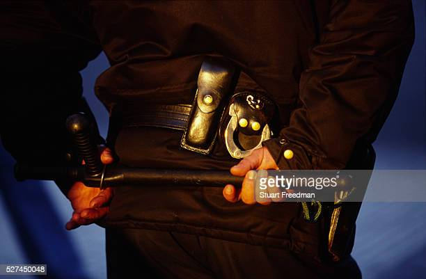 Riot policeman with truncheon