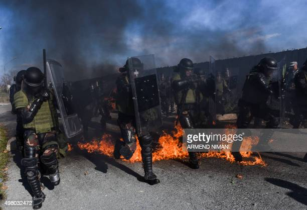 Riot policemen and soldiers serving in the NATOled peacekeeping force take part in a crowd and riot control exercise near the village of Vrelo on...