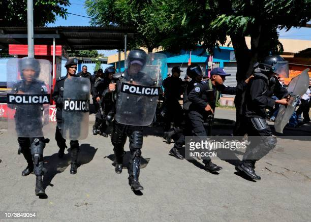Riot policemen are deployed to clear journalists from the surroundings of the Plaza El Sol police station as Nicaraguan journalist Carlos Fernando...