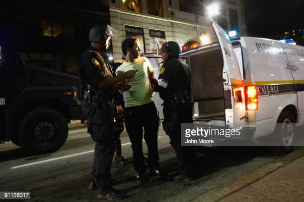Riot policemen arrest a man detained during a protest against the G20 Summit early on September 25 2009 in Pittsburgh Pennsylvania Riot police with...