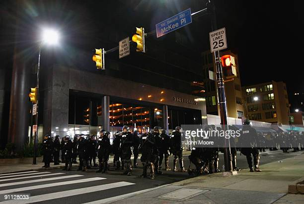 Riot policemen block off a street after breaking up a protest against the G20 Summit early on September 25 2009 in Pittsburgh Pennsylvania Riot...