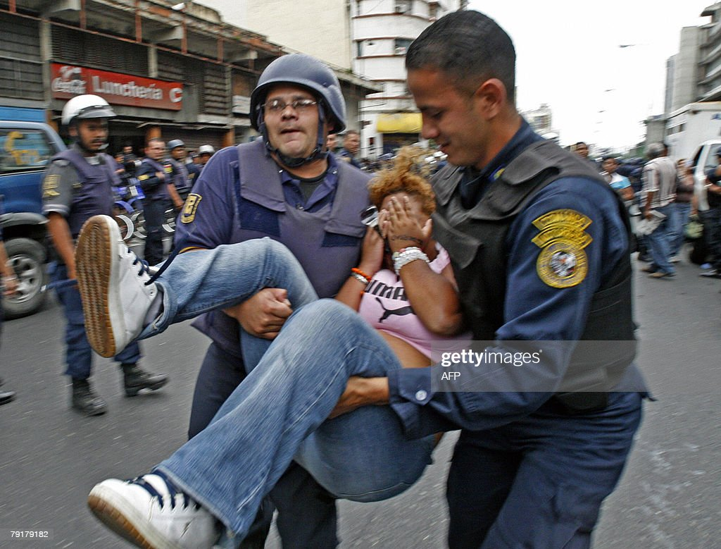 Riot policemen carry an opponent of Venezuelan president Hugo Chavez during a demonstration 23 January, 2008 in Caracas. The Venezuelan government commemorated today the 50th anniversary of the fall of the last dictatorship -gen. Marcos P?rez Jim?nez (1948-58). AFP PHOTO/Enrique HERNANDEZ