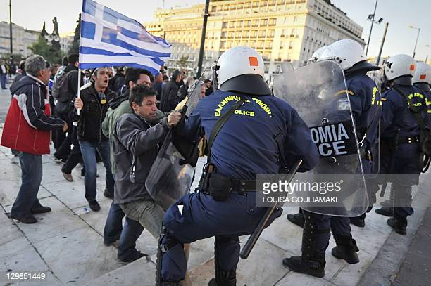 Riot policemen clash with demonstraters at a protest in Athens on October 19 during a twoday general strike against new austerity measures and ahead...