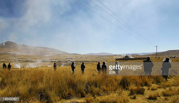 Riot policemen clash with local miners holding a protest against Swissowned mining company Xstrata in Espinar Cuzco100 kms southeast of Lima At least...