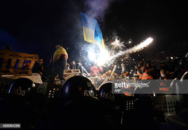 Riot policemen clash with protesters on Independence Square in Kiev on December 11 2013 Ukrainian security forces on December 11 moved away from the...