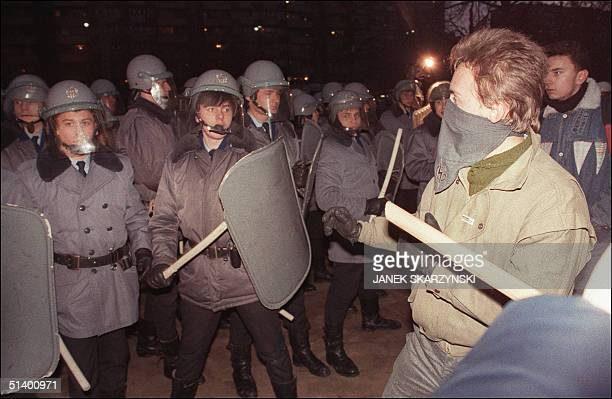 Riot policemen confront radical antiCommunist students 27 January 1990 in Warsaw in front of Polish United Workers Party headquarters during the...