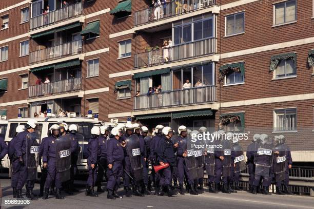 Riot policemen during the march against military bases of Torrejon A group of national riot policemen expects the demonstrators from the march to...