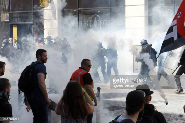 Riot policemen launch tear gas canisters against demonstrators in Lille as part of a multi branch day of protest called by French unions CGT and...
