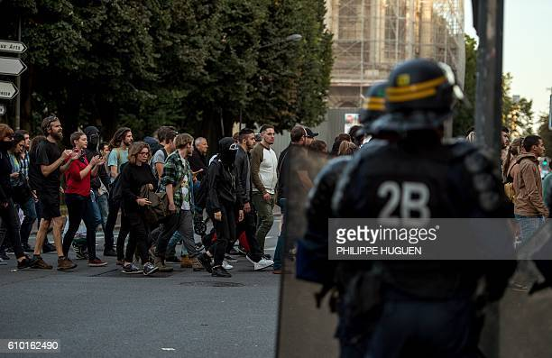 Riot policemen onwatch as some 500 people, mainly from far-left groups, protest on September 24, 2016 in Lille against the opening of a private bar...