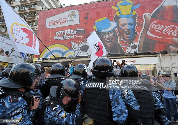 Riot policemen prevent blocking of a street by supporters of former Prime Minister of Ukraine Yulia Tymoshenko during their rally in Kiev near...